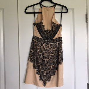 bebe Dresses - BEBE black and nude lace detail dress